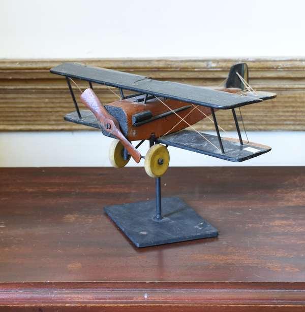 Vintage folk art bi-plane old paint on stand