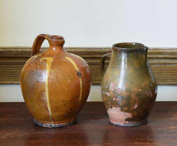 Redware pouring pitcher with manganese spots