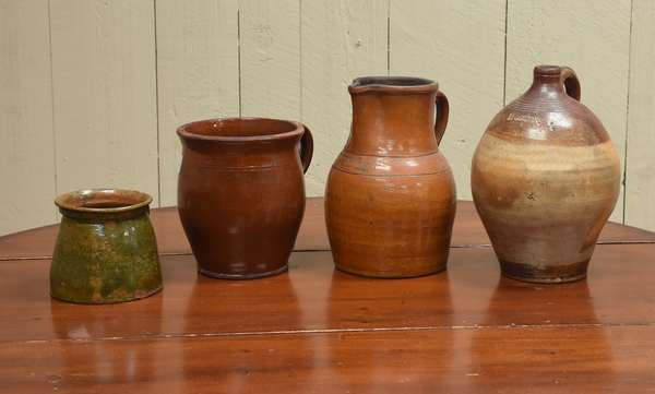 Two redware handled pots with a Harrisburg V.A. pitcher and a Boston jug, 4 pcs