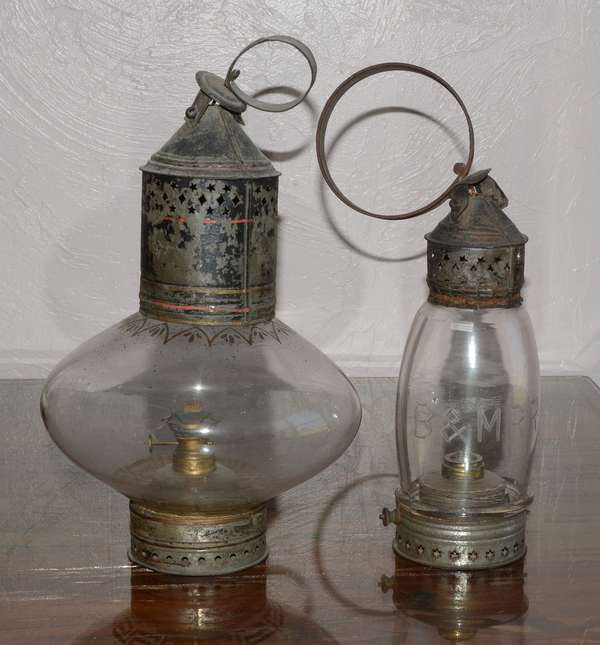Two early oil lanterns, onion shaped with original burner, 15