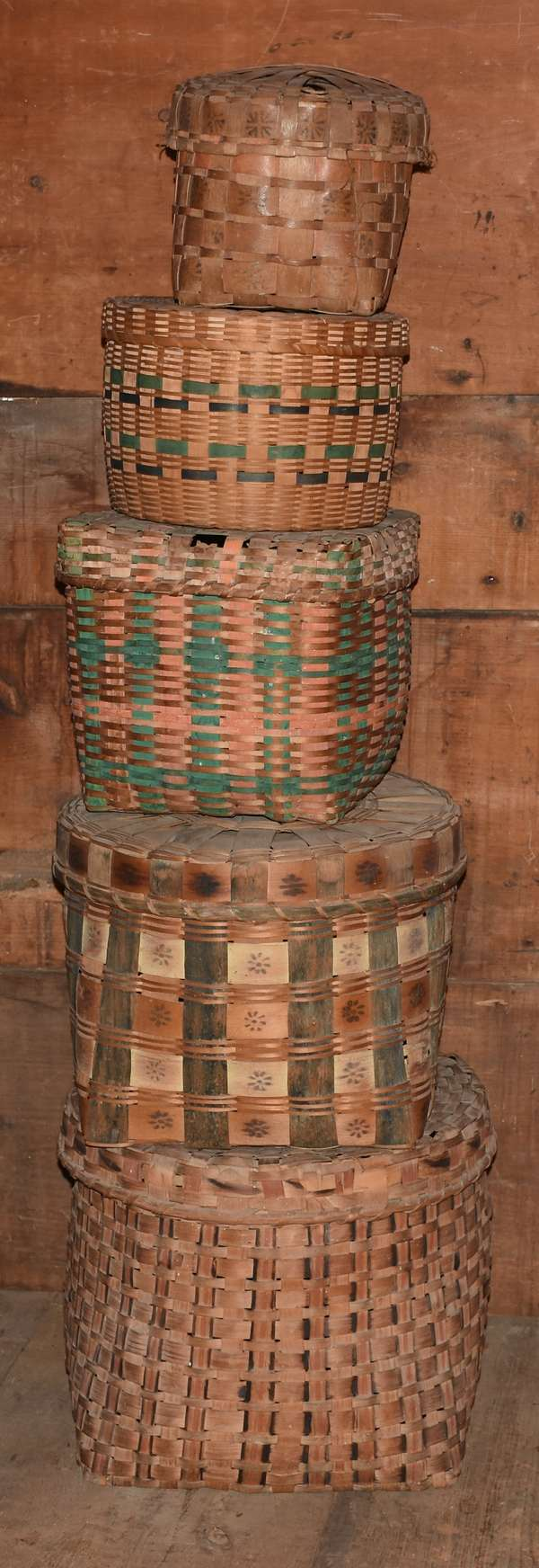 Nesting group of five Northern Woodland Indian polychrome decorated splint baskets, 8
