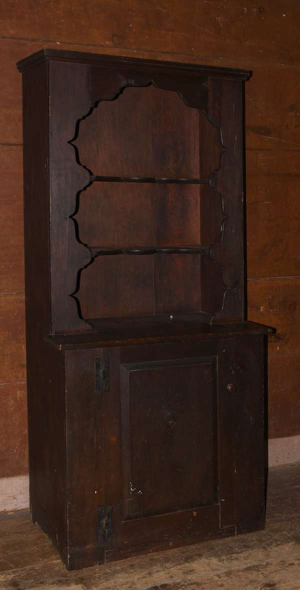 Pine cupboard with shaped cut-out top and one lower drawer, 73