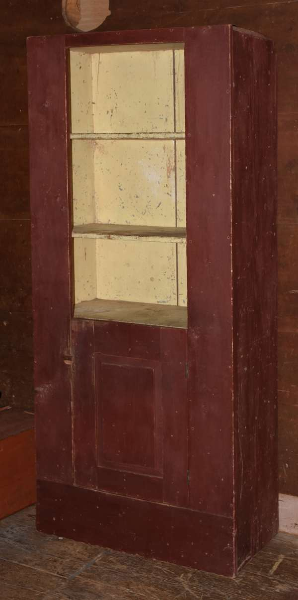 Country cupboard in old red paint with one lower door, 71.5