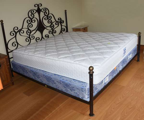 Wrought iron decorative King size bed with mattress