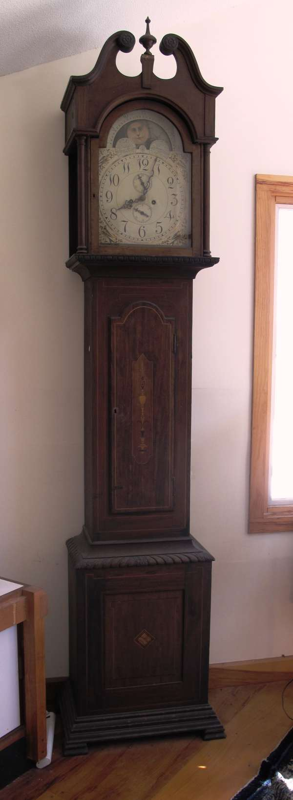 Inlaid mahogany tall Grandfather clock, weight driven brass works signed on back of works