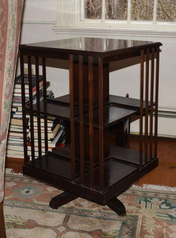 Two 20th C. revolving bookcases 34.5