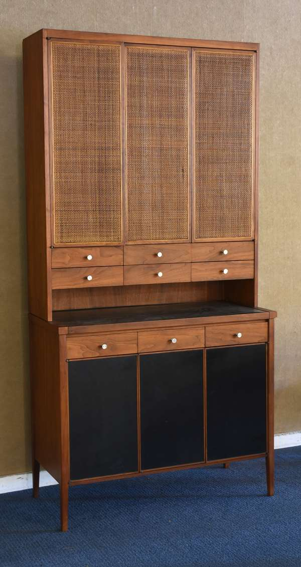 "Two part Paul McCobb cabinet, teakwood with rattan upper doors, 38""L x 77""H"
