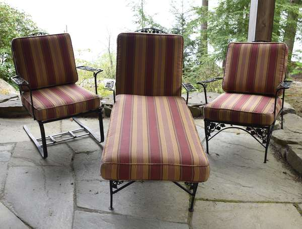 Three piece patio set-iron inc chaise lounge, stanchion rocker and an arm chair