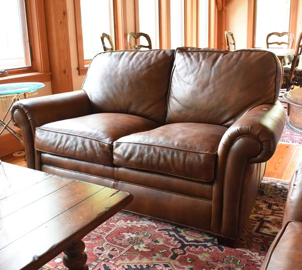 "Hancock & Moore two cushion leather loveseat, 62""L."