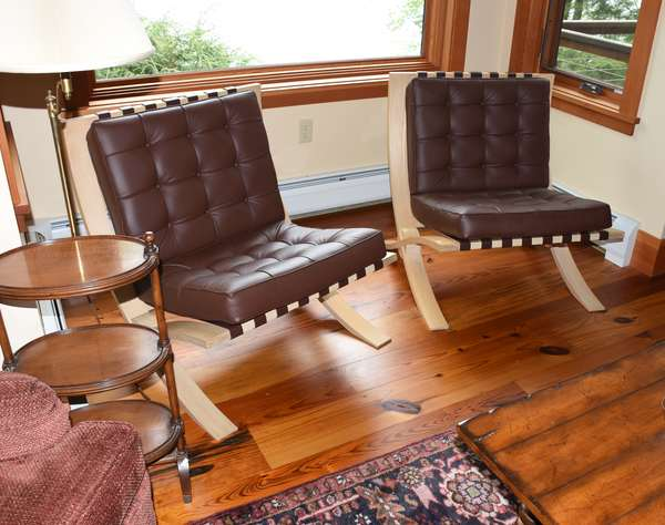 Pair of bench-made Barcelona chairs, wood and brown leather