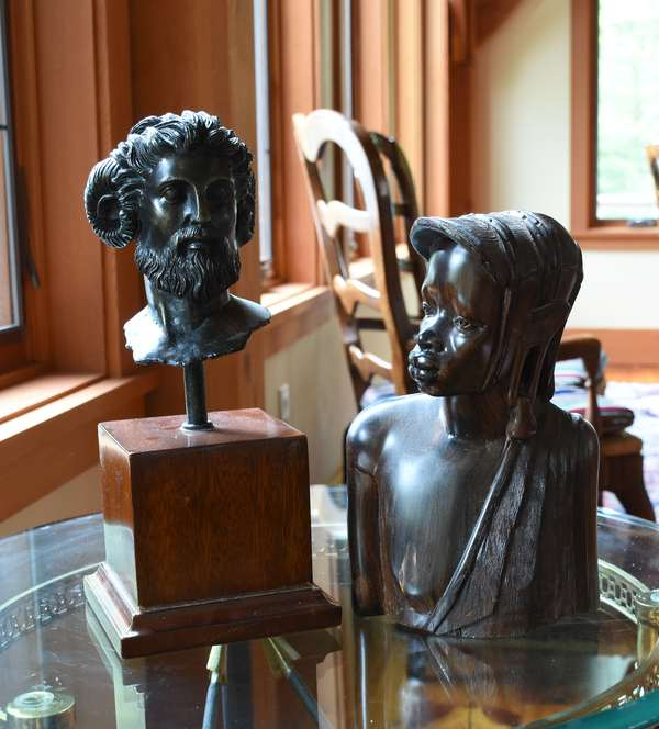 Reproduction bronze sculpture along with a carved wooden ethnic sculpture 10