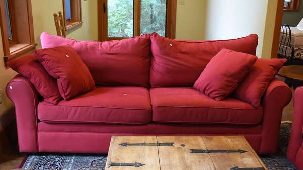 Red upholstered sofa, 7'4