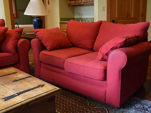 Red upholstered settee, 66