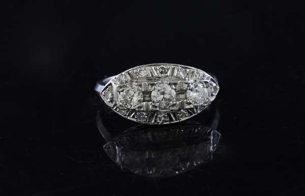 Platinum and diamond ring, three diamonds in a row, approx. .33 ct each with other diamonds, ring size 6.25, 5 grams