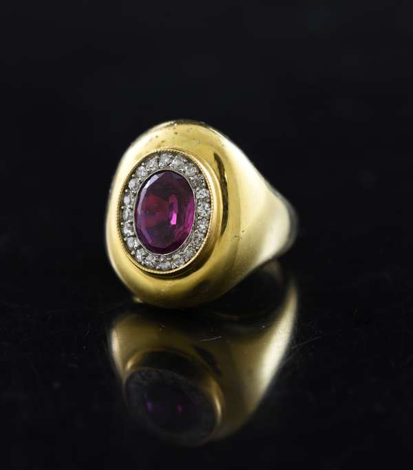 18k yellow gold ruby and diamond ring, ruby measures 6.6mm x 9.2mm surrounded with diamonds, signed Jose, 12 grams, ring size 6.5