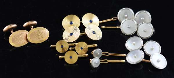 Three sets of 14k gold cufflinks, five piece set with sapphires, eight piece MOP set and two piece set, 39 grams