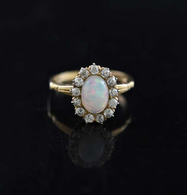 14k yellow gold opal and diamond ring, opal measures 6.2mm x 8.3mm, ring size 5.75