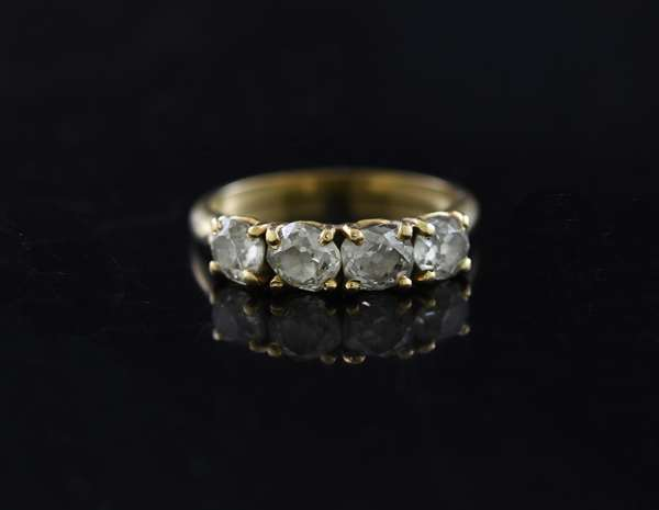 14k yellow gold band set with four old mine cut diamonds, approx. 1.2 ctw., size 6