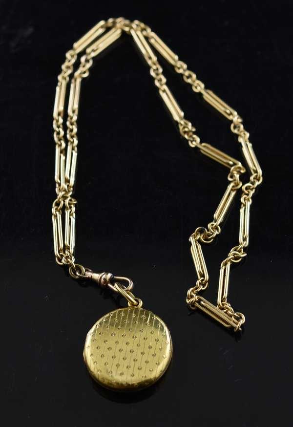 14k gold oval locket pendant, 7 grams, on a 14k gold 22