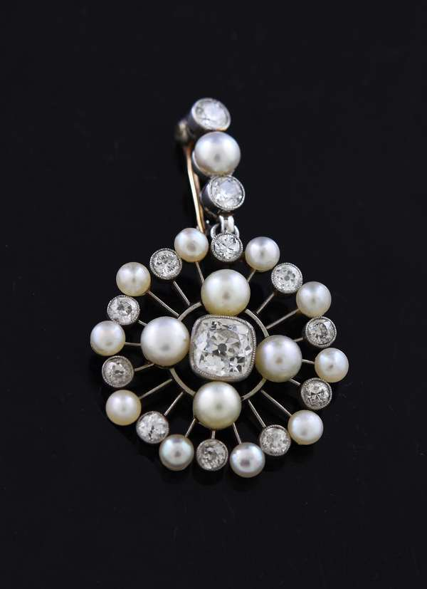 Antique platinum diamond and pearl pin or pendant, center cushion cut diamond approx. .60 ct with twelve other diamonds, 1.5