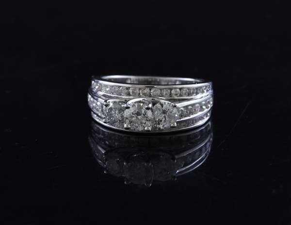 14k white gold diamond ring, three stone center .25, .35, .25 ct stones with other diamonds, size 7