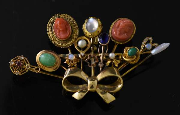 Gold pin, with assorted stick pins added, 3.5