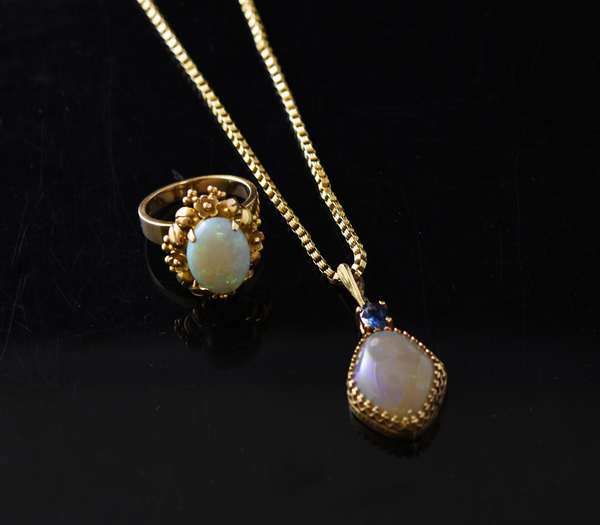 Opal and sapphire 14k gold pendant with chain along with an opal and 14k gold ring, 18 grams