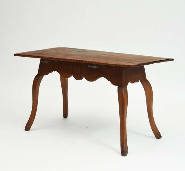 18th C. tiger maple work table with heavily scrolled apron on cabriole legs with hoof feet, 47.5