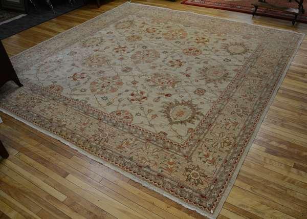 Room size Oriental rug, ivory field 12'1