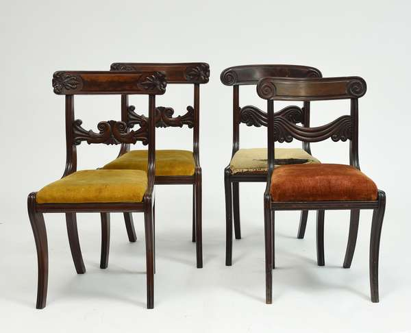 Two pairs of Classical Boston mahogany chairs with well carved backs, sabre legs, ca.1830