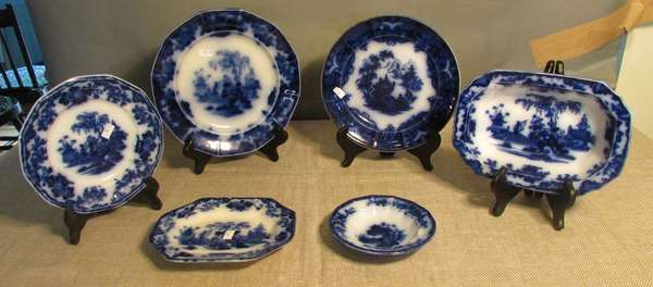 "Six pieces of Flow Blue including small Scinde serving dish 8½""; a small unmarked Flow Blue dish 5½""Dia.; a Flow Blue Formosa plate 9""; small Flow Blue platter 7½""; and two small Flow Blue Scinde plates 8""Dia., 9½""Dia. (75-18)"
