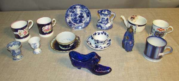 "Small collection of china including a Daisy and Button glass shoe vase 6""L., various English china cups, no marks; two English cups and saucers, no marks, Masons china pitcher 4""H.; two small handless cups; Chinese Mud Man marked ""China"" 4""H. (75-19)"