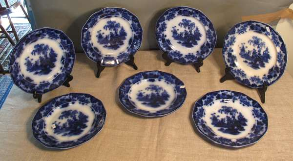 "Seven Flow Blue Scinde plates, 10 ½""D. (75-53)"