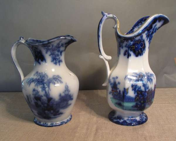 "Two Flow Blue Scinde pitchers, 10"" and 12""H. (75-68)"