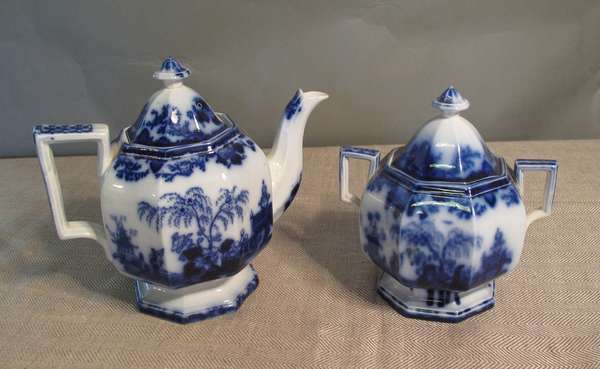 "Flow Blue Scinde teapot with age crack, 9""H., along with a Flow Blue sugar bowl, 8""H. (75-69)"