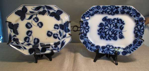 "Two Flow Blue platters, one strawberry design and one floral design, 13½""L and 14""L. (75-74)"