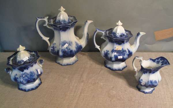 "Four piece Flow Blue Scinde tea set including coffee pot, teapot, sugar bowl and creamer, 12""H., 10""H., 8""H., 7""H. (75-106)"