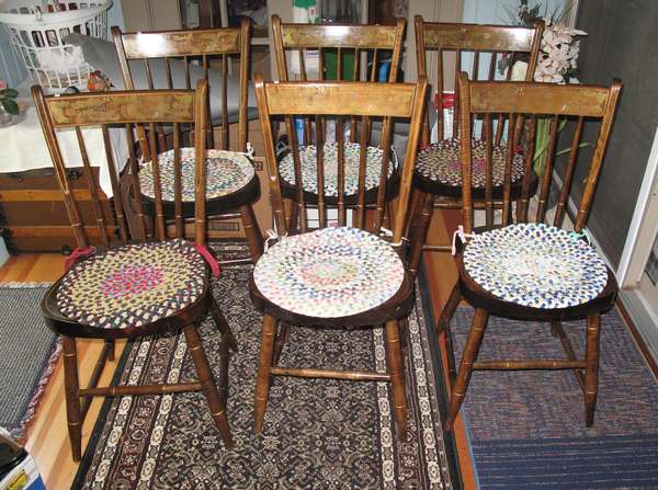 Set of seven thumbtack chairs with decoration Including one odd arm chair with no decoration (copies) (75-147)