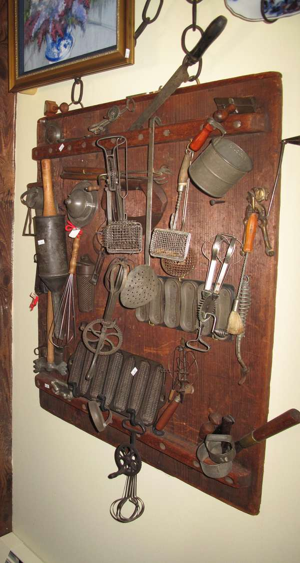Collection of kitchen utensils including cookie mold, mixers, egg beaters, skimers, gem pans, measuring cups, etc. (75-189)