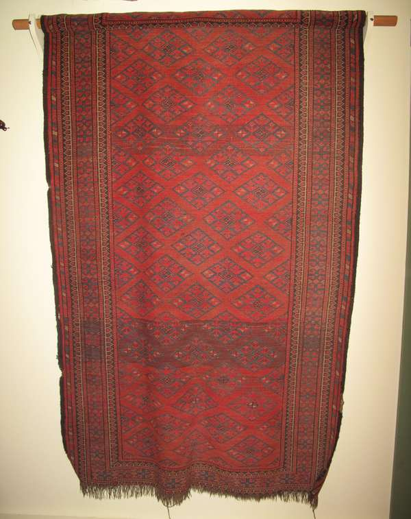 "Oriental Bokhara scatter rug. Approx. 3'6"" x 6' (partially rolled) (75-196)"