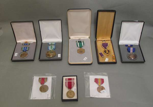 "Collection of eight military medals including ""WWII Freedom of Speech and Religion"", ""Military Merit"", ""National Defense"", ""Purple Heart Military Merit"" ""Military Achievement"", ""Military Conduct"", ""For Civilian Service"", ""Military Merit"" (75-226)"