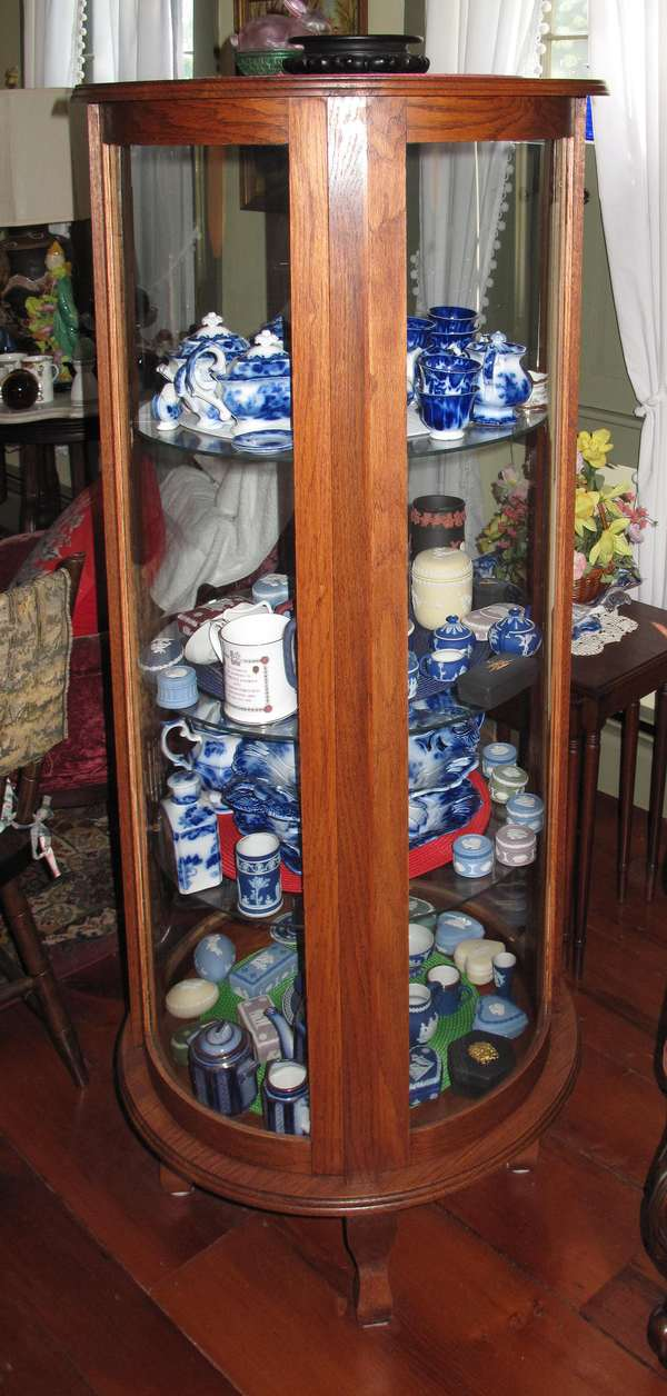 "Reproduction oak circular china cabinet with glass shelves. 4'10""H (75-275)"