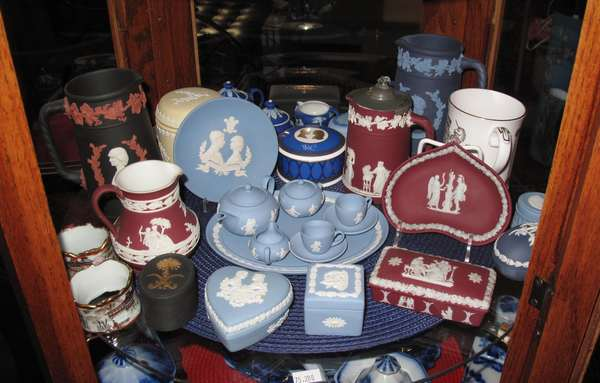 Shelf #2 of curio cabinet: Collection of Wedgwood Jasperware including pitchers, dolls, creamers, carved boxes. Approx. 28 pcs. (75-280)
