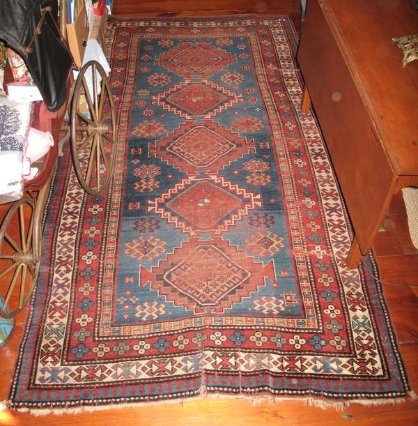 "Multi-­?colored Oriental rug with medallions. Approx. 4'6"" x 8'2"" (area wear) (75-293)"