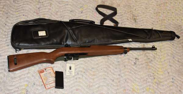 Ref 4: Universal Hialeah FLA 30 Caliber Rifle with case.
