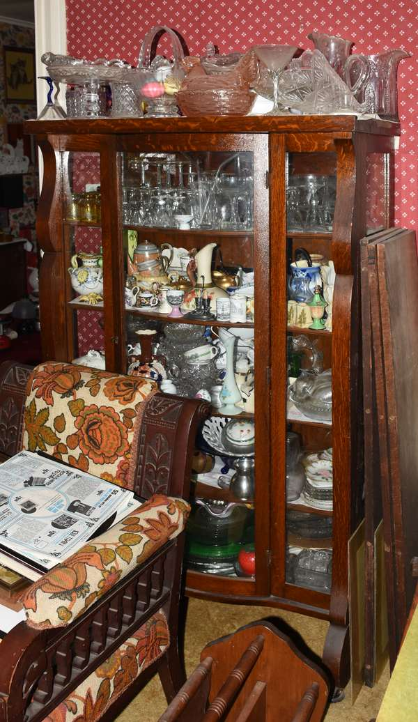 China cabinet filled with glass and porcelain