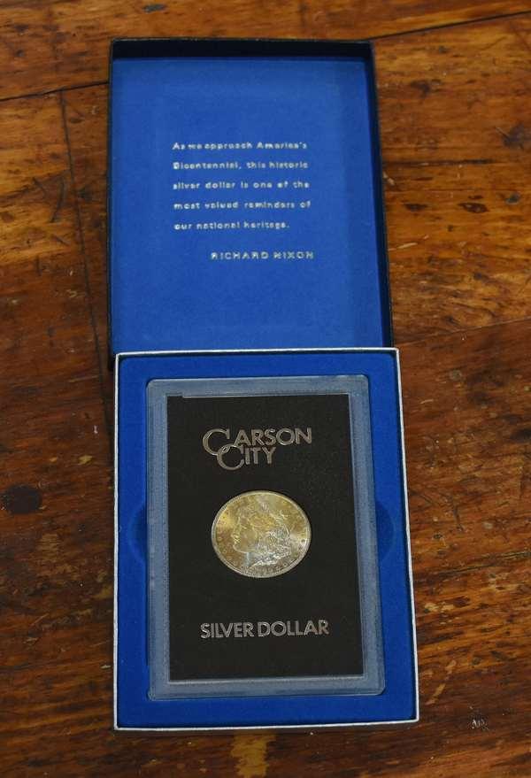 Ref 5: 1883-cc GSA Morgan silver dollar (762-30)
