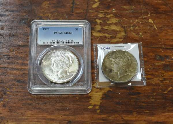 Ref 9: 1921 & 1927 Peace silver dollars (532-123)