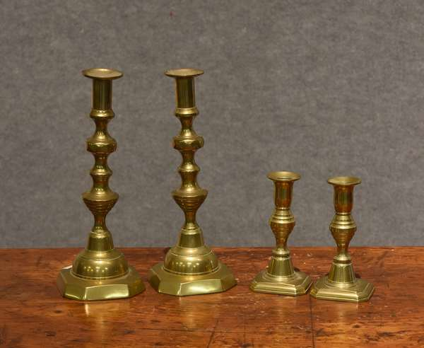 Two pairs of brass candlesticks (44-35)