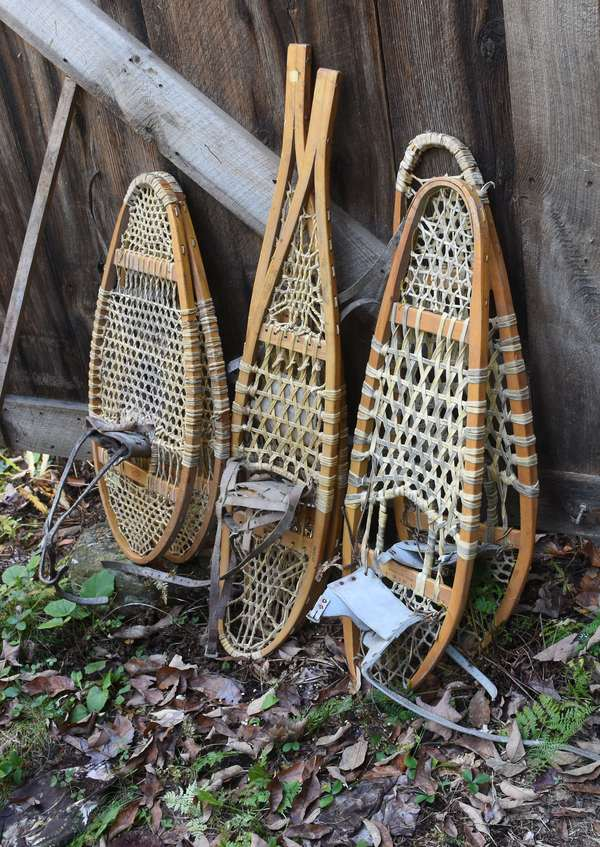 Three pairs of snowshoes, one stamped Vermont Tubbs (48-343)